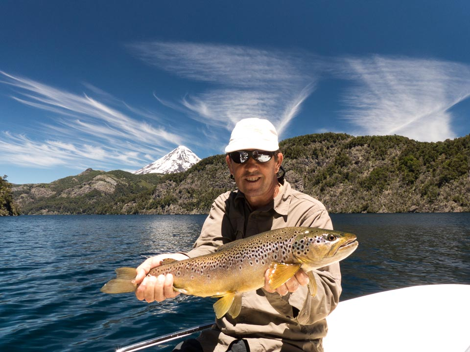 Fly fishing with dries on the Tomen Lake - Patagonia Argentina.